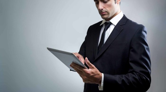 Portrait of young Businessman Using Digital Tablet
